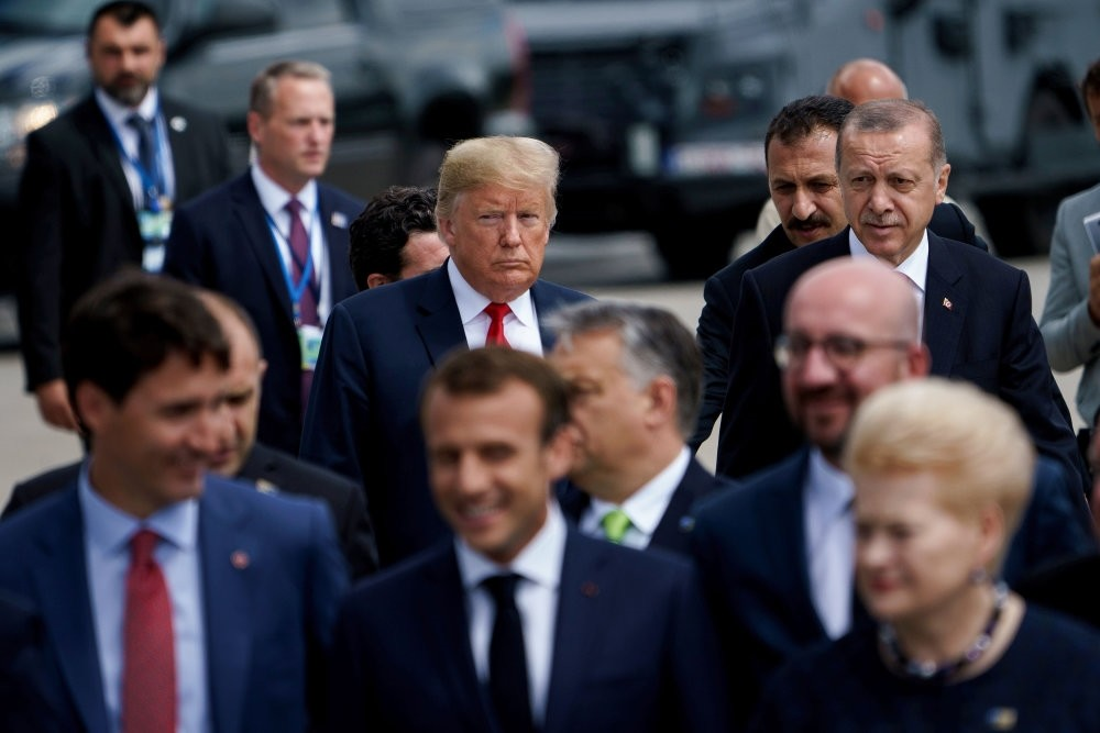 President Recep Tayyip Erdou011fan (R) and U.S. President Donald Trump (L) follow other leaders for a photo shoot during the NATO summit in Brussels, July 11.