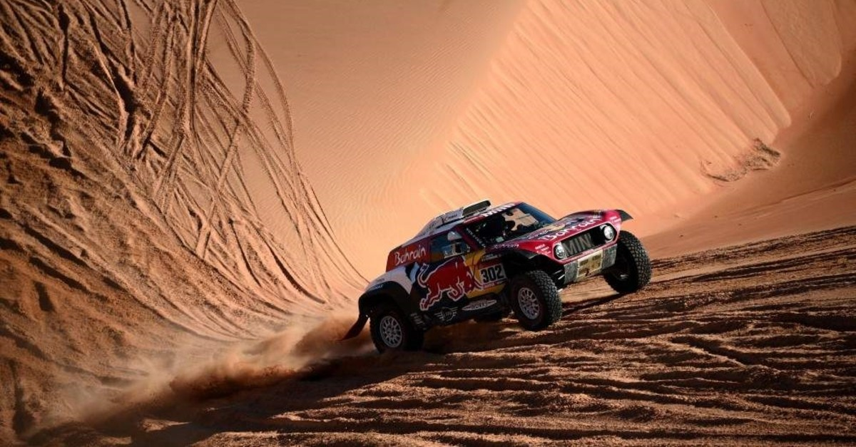 Stephane Peterhansel and his co-driver Portuguese Paulo Fiuza compete during the Stage 11 of the rally between Shubaytah and Haradh, Saudi Arabia, Jan. 16, 2020. (AFP Photo)