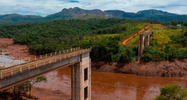 Aerial view of rail bridge taken down by a mudslide after the collapseof a dam at an iron-ore mine belonging to Brazil's giant mining company Vale, Jan. 27, 2019. (AFP Photo)