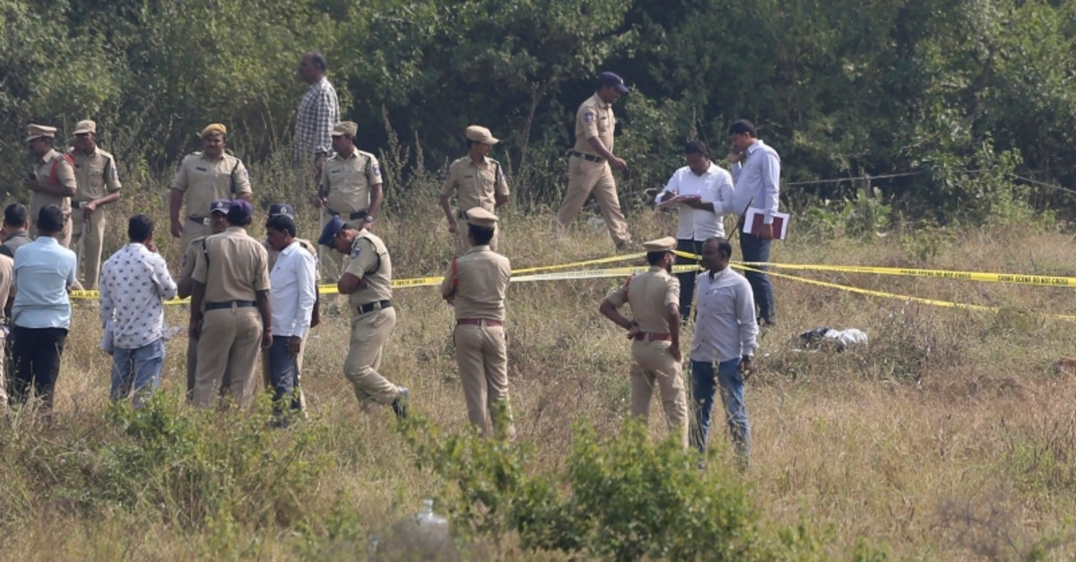 Indian police officials secure the area where four men suspected of raping and killing a woman were killed in Shadnagar some 50 kilometers from Hyderabad, India, Friday, Dec. 6, 2019. (AP Photo)