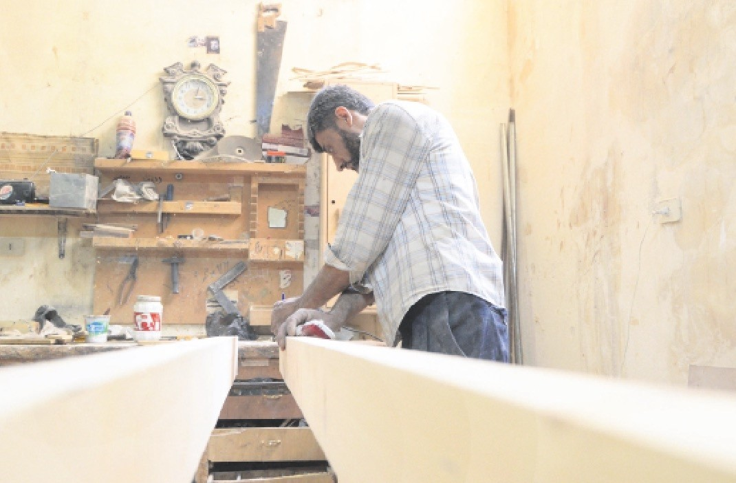 Yussef al-Qabuni has also gone back to work, fixing doors, windows and pieces of furniture for a handful of customers.