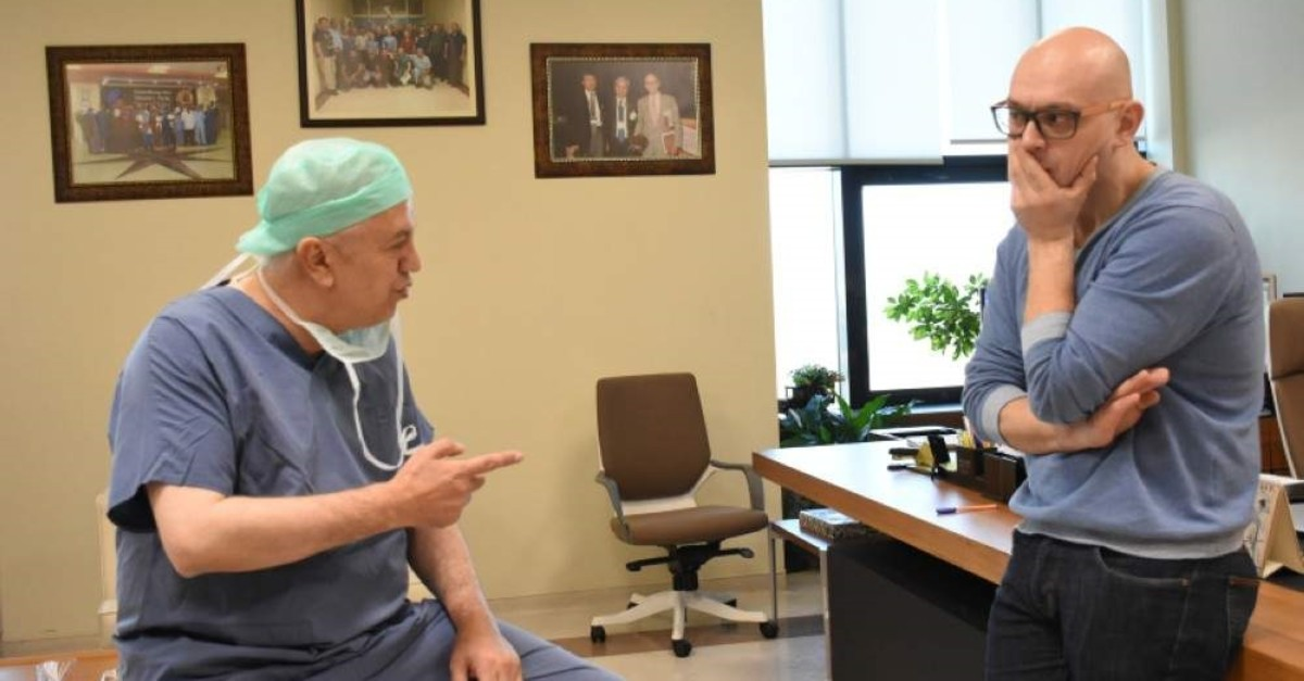 Dr. Sezai Y?lmaz discusses transplant techniques with his Russian colleague Vasemin Sergey Andreevich, Malatya, Turkey, Nov. 19, 2019. (AA Photo)