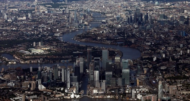 Canary Wharf and the City of London financial district are seen from an aerial view in London, Britain, August 8, 2019. (Reuters Photo)