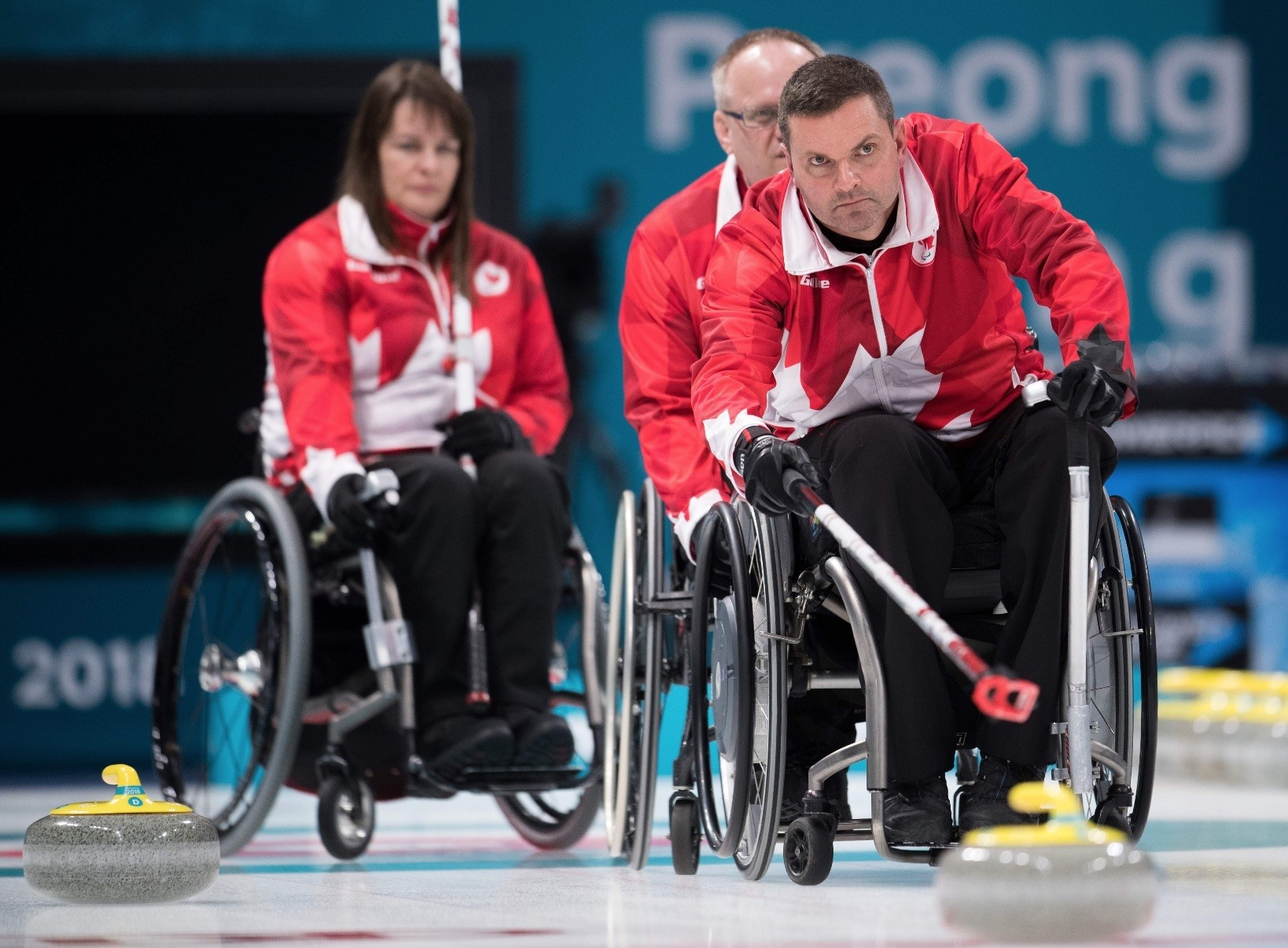 Canadau2019s Mark Ideson (R) attends a wheelchair curling practice ahead of the Pyeongchang 2018 Paralympic Winter Games at the Gangneung Curling Centre.