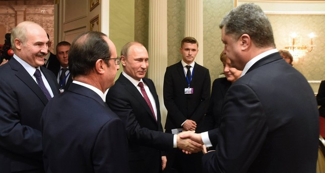 Russian President Vladimir Putin with Ukrainian President Petro Poroshenko in a meeting on Feb. 11, 2015, in Minsk.