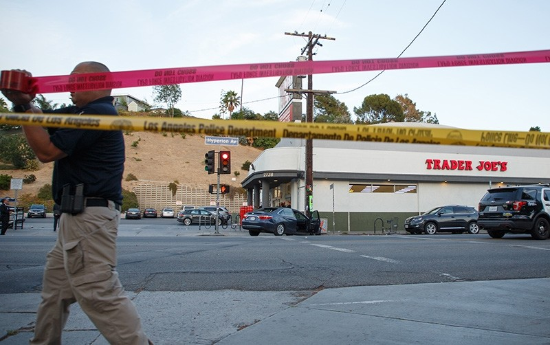 Police investigate the aftermath of a hostage situation at the Trader Joes grocery store in the Silver Lake neighborhood of Los Angeles, California, USA, July 21, 2018. (EPA Photo)