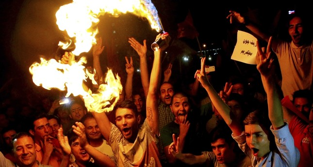 Iranians celebrate following a landmark nuclear deal in Tehran, Iran, July 14, 2015. Since becoming president early last year, Donald Trump has supported Israel and the Gulf's anti-Iran agenda and has attacked the nuclear deal.