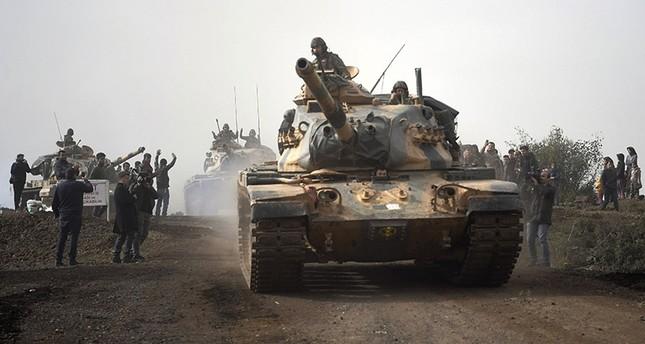 Turkish army tanks enter Afrin in Hassa, Hatay, Turkey, Monday, Jan. 22, 2018. (AP Photo)