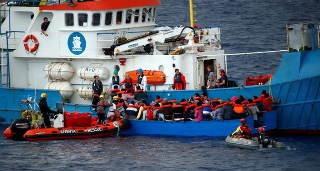 Migrants on a wooden boat are rescued by German NGO Jugend Rettet ship Juventa crew in the Mediterranean sea off Libya coast, June 18, 2017. Reuters Photo