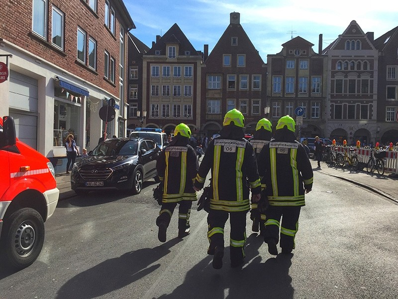 Firefighters walk in  downtown Muenster, Germany, Saturday, April 7, 2018 (AP Photo)