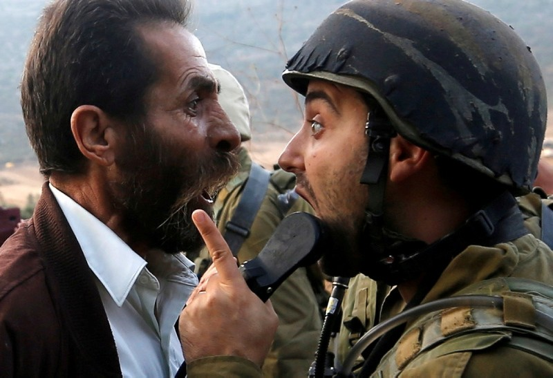 A Palestinian man argues with an Israeli soldier during clashes over an Israeli order to shut down a Palestinian school near Nablus in the occupied West Bank, Oct. 15, 2018. (Reuters Photo)
