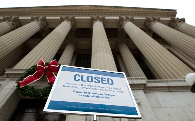 A closed sign is displayed at The National Archives entrance in Washington, Tuesday, Jan. 1, 2019, as a partial government shutdown stretches into its third week. AP Photo