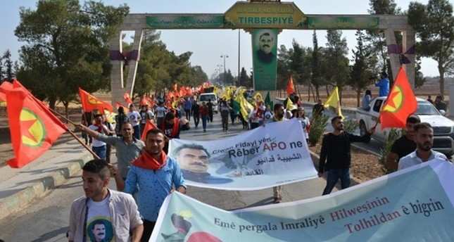 Syrian PYD terrorists brandish banners of PKK, Öcalan in yet another proof of ties