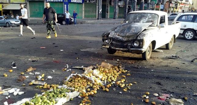 صورة وزعتها وكالة إعلام النظام السوري عن موقع التفجير (AP)