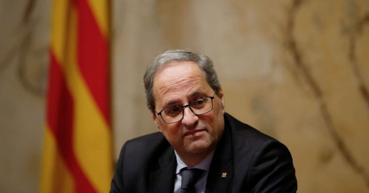 Catalan regional president, Quim Torra, presides over an extraordinary meeting with his cabinet at the government headquarters in Barcelona, Jan. 3, 2020. (AFP Photo)