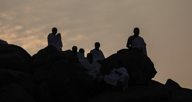 Muslim pilgrims pray during the Hajj on Mount Arafat near Mecca, a day prior to Eid al-Adha.
