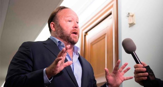 In this file photo taken on Sept. 5, 2018 right-wing conspiracy theorist Alex Jones speaks with reporters. AFP Photo