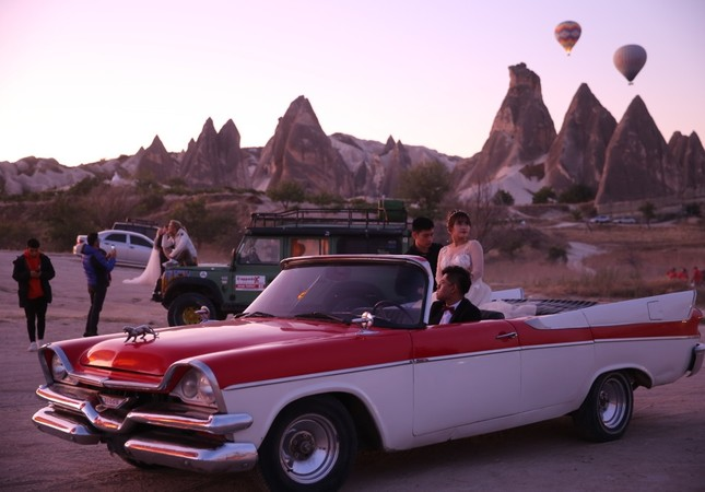 Classic cars add a magical atmosphere to Cappadocia's landscape.