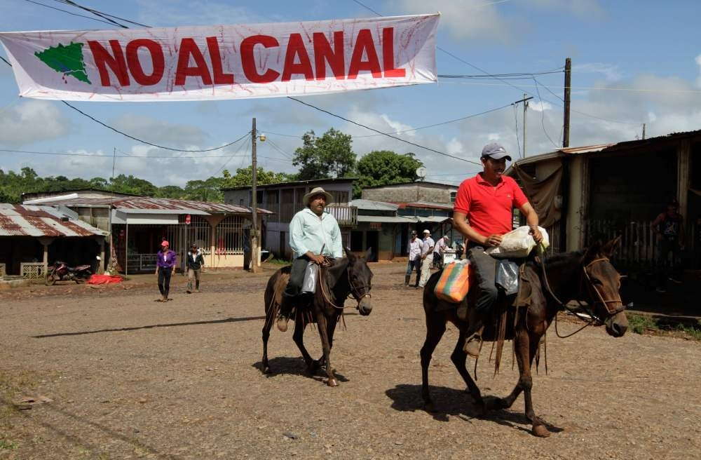 Peasants on horseback arrive to join a march against the construction of an interoceanic major canal in Nicaragua, in La Fonseca, a remote village along the proposed canal route that would be destroyed by the project.