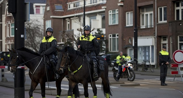 Dutch mounted police patrols as other police officers block the road leading to the Turkish consul's residence in Rotterdam, Netherlands, Saturday, March 11, 2017 (AP File Photo)