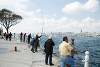 A young man who went for a walk by the Bosporus lost his eyesight and ability to speak after being hit by a careless fisherman's sinker and barb.