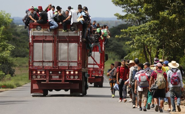 Central American migrants, part of the caravan hoping to reach the U.S. border, get a ride on a truck, in Isla, Veracruz state, Mexico, Nov. 3.