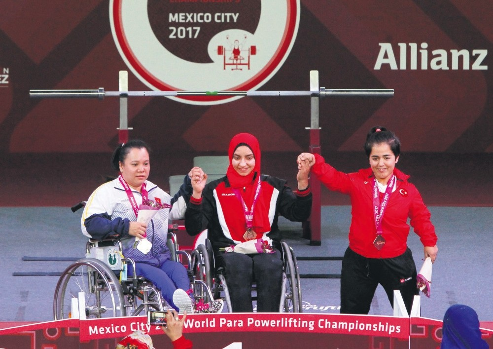 Thi Lihn Phuong Dang (L) of Vietnam, Rehab Ahmed of Egypt and Besra Duman (R) of Turkey pose with their medals during the Paralympic Weightlifting Championships.