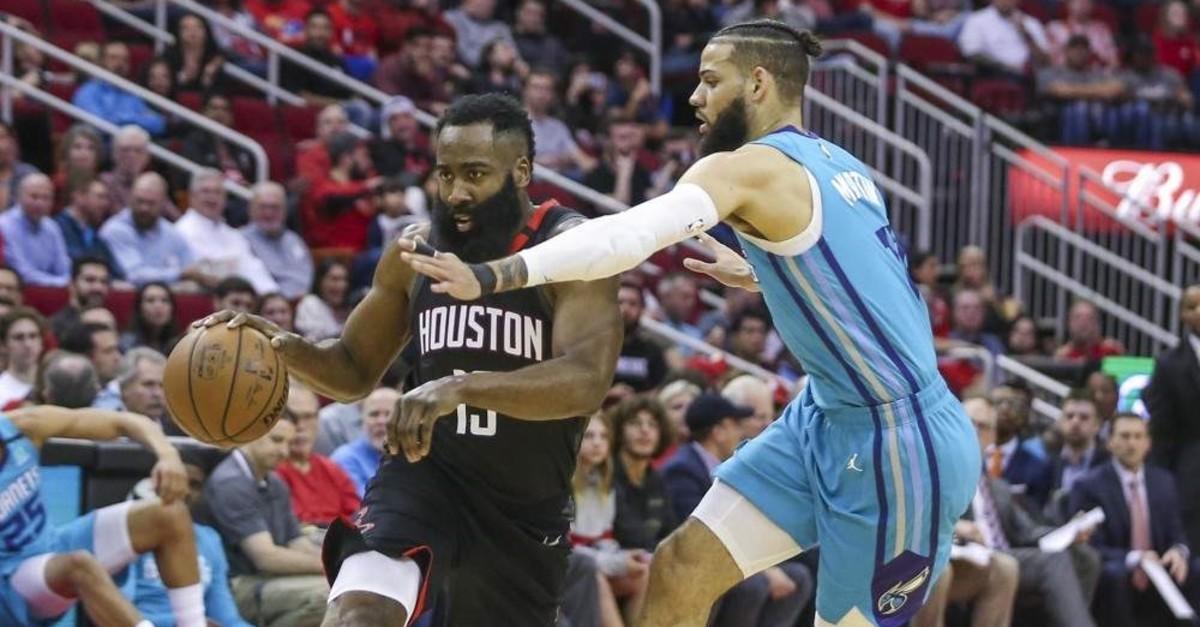 Harden (13) dribbles around Charlotte Hornets forward Cody Martin during the second quarter, Houston, Feb. 4, 2020. (Reuters Photo)