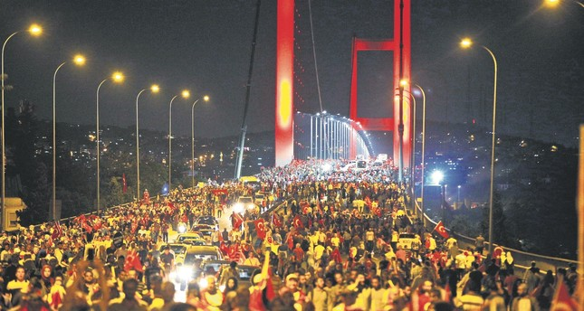 People protest against the July 15 coup attempt on Istanbul's Bosporus Bridge, July 21, 2016.