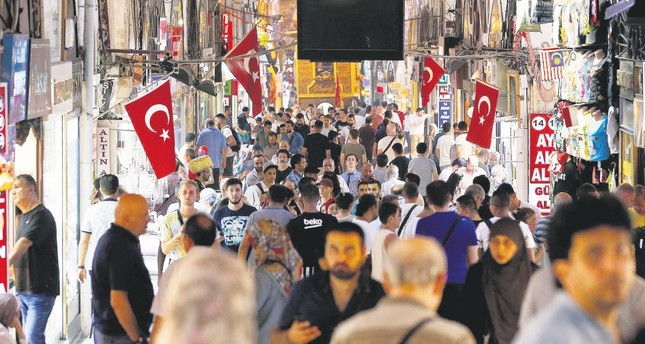 People walk inside Istanbul's Grand Bazaar, Friday, Aug. 17, 2018.