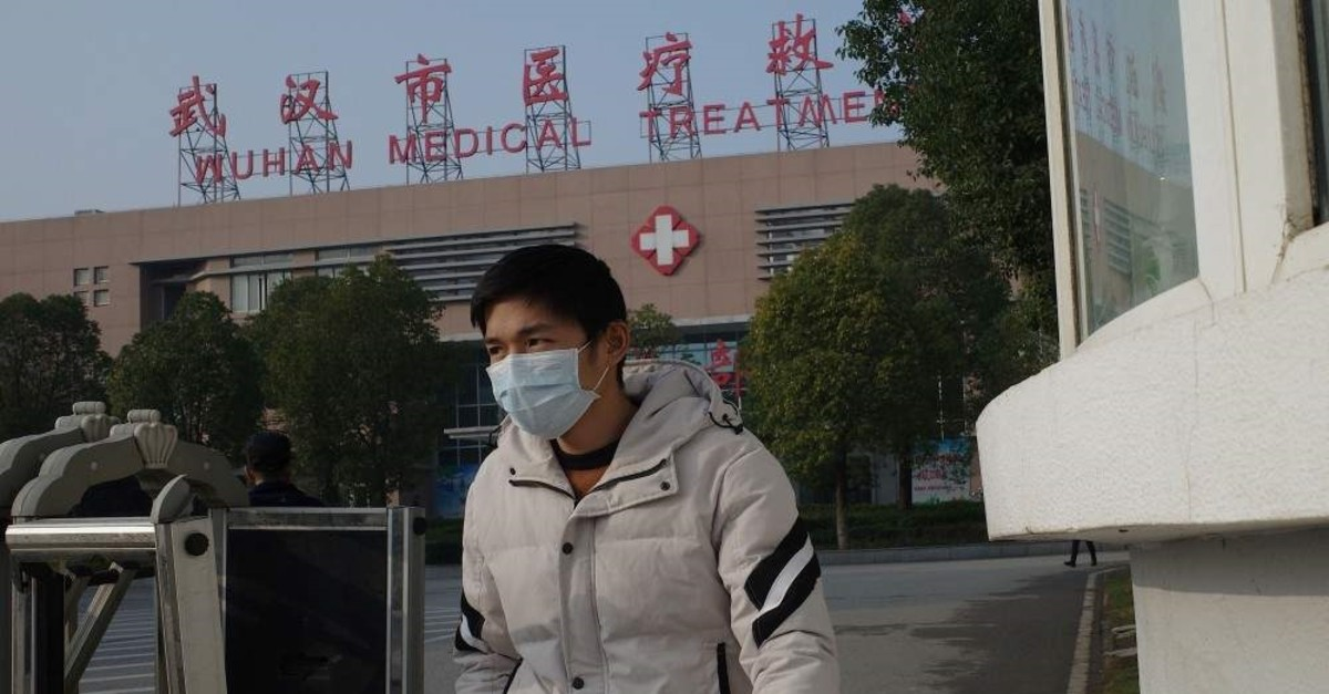 A man leaves the Wuhan Medical Treatment Center, Wuhan, Jan. 12, 2020. (AFP Photo)