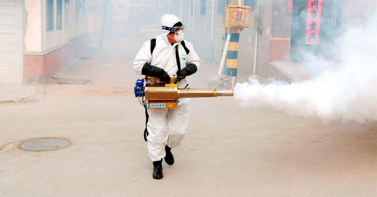 A worker in protective suit disinfects the Dongxinzhuang village, as the country is hit by the new coronavirus, in Qingdao, Shandong province, China, Jan. 29, 2020. (REUTERS Photo)