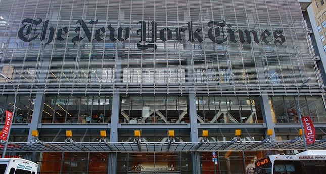 In this file photo taken on February 26, 2017 People take part in a protest outside the New York Times in New York. (AFP Photo)
