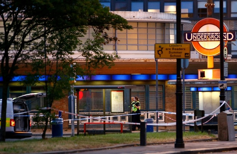 Police stand at the scene after several people were injured after a small explosion at Southgate Underground station in north London, Britain June 19, 2018. (Reuters Photo)