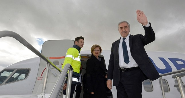 President of the Turkish Republic of Northern Cyprus (KKTC) Mustafa Akıncı (R) waves as he boards a plane at Ercan Airport in Turkish Republic of Northern Cyprus on Jan. 8, 2017. (AFP Photo)