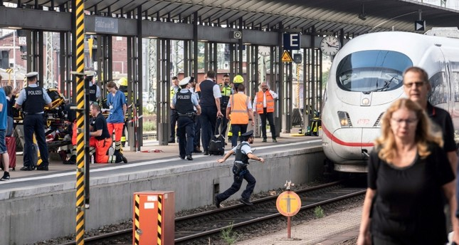 Firefighters and Police officers stay next to an ICE high-speed train at the main station in Frankfurt, Germany, Monday, July 29, 2019. (AP Photo)