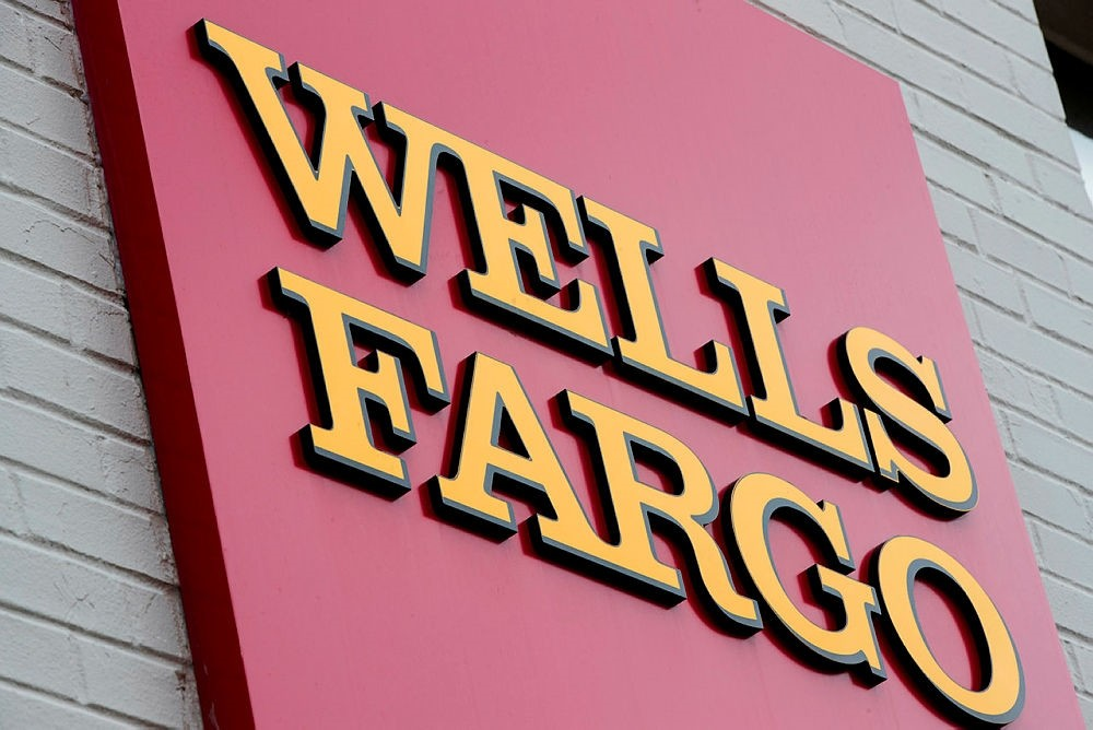 This Aug. 11, 2017, file photo shows a sign at a Wells Fargo bank location in Philadelphia. (AP Photo)