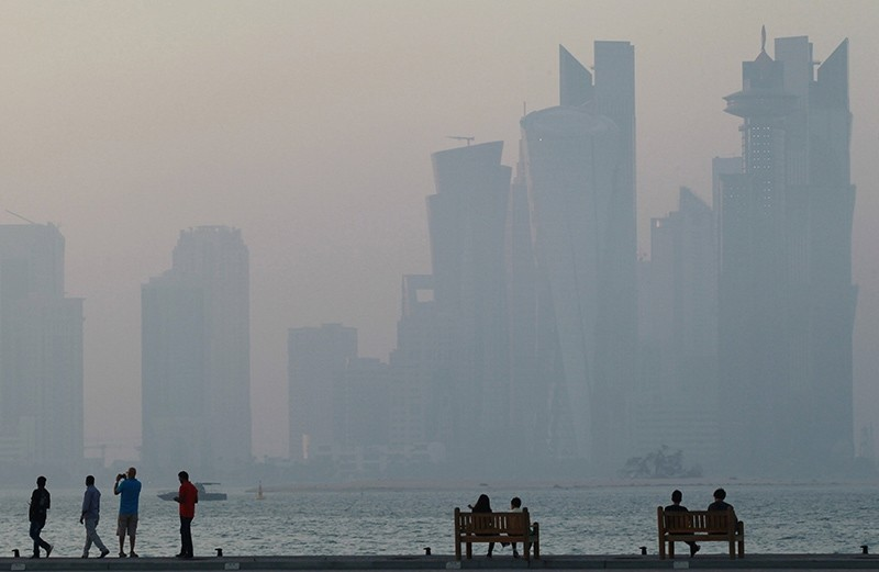 People sit on the corniche in Doha, Qatar, June 15, 2017. (Reuters Photo)