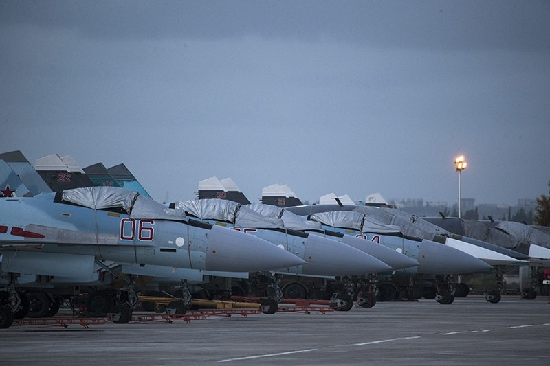 Russian fighter jets and bombers are parked at Hemeimeem Air Base in Syria, Friday, March 4, 2016. (AP Photo)