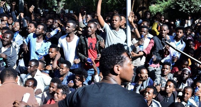 Supporters of Jawar Mohammed, a member of the Oromo ethnic group who has been a public critic of Abiy, gather outside his home in the Ethiopian capital, Addis Ababa. (AFP)