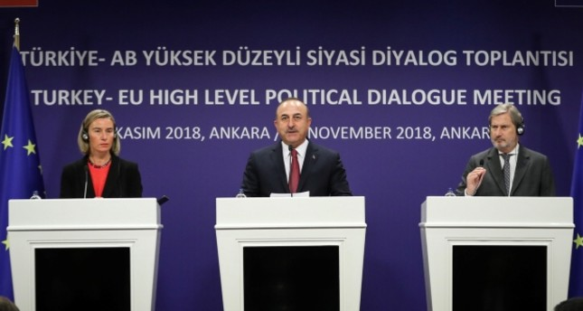 Foreign Minister Mevlüt Çavuşoğlu (C), EU Foreign Chief Federica Mogherini (L) and EU Enlargement Commissioner Johannes Hahn attend a joint press conference after a meeting in Ankara, Nov. 22, 2018. (AA Photo)