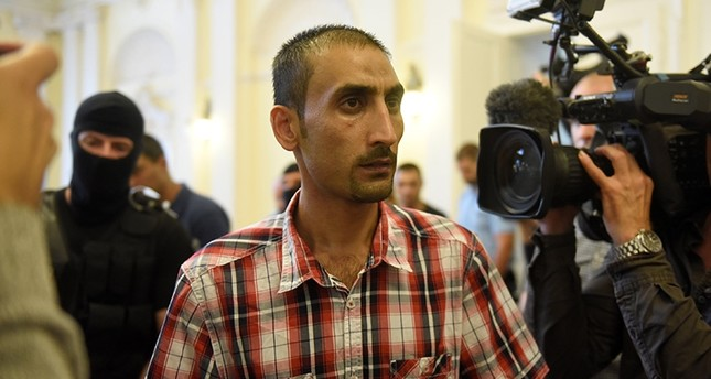 The Afghan leader of a people-smuggling group looks at the media, as he leaves the courtroom, after a guilty verdict in Kecskemet, Hungary, June 14, 2018. (Reuters Photo)