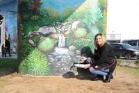 Moldovan artist transforms city walls into works of art