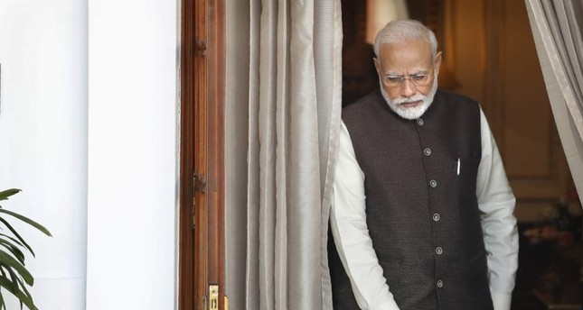 Indian Prime Minister Narendra Modi leaves the room to receive Portuguese President Marcelo Rebelo de Sousa, New Delhi, Feb. 14, 2020. AP Photo
