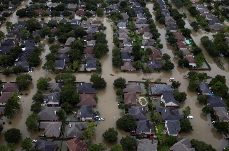 Houses are seen submerged in flood waters caused by Tropical Storm Harvey in Northwest Houston, Texas, U.S. August 30, 2017. (Reuters Photo)