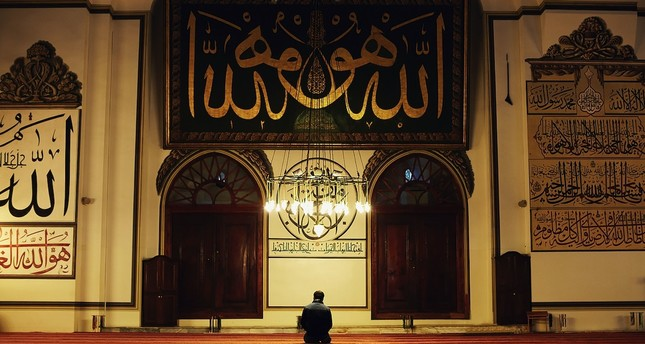A man praying in the Great Mosque in Bursa, western Turkey.