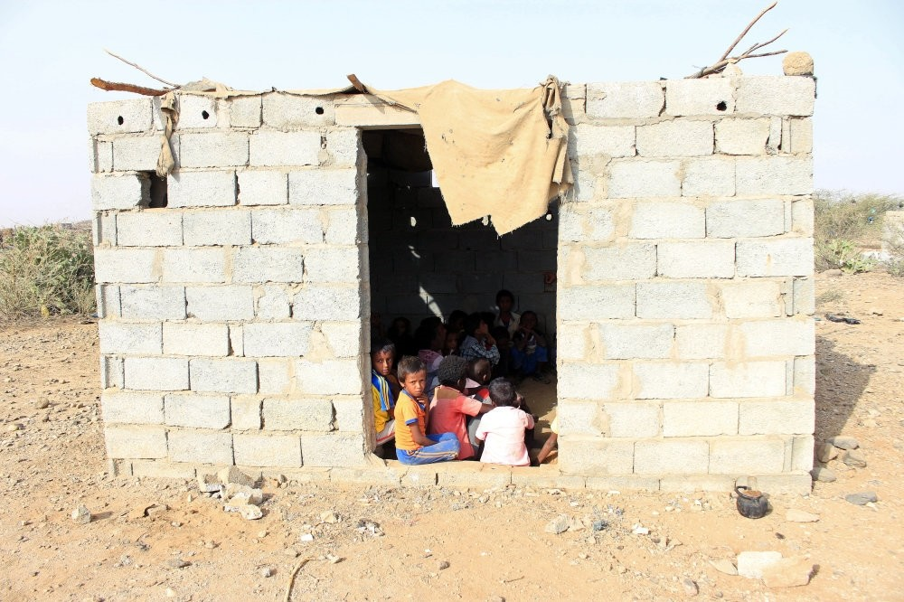 Students displaced from different cities in Yemen's northwestern province of Hajjah attend a class, Jan. 27, 2019.