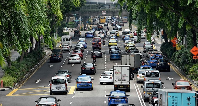 Motorists enter the financial district area in Singapore AFP Photo