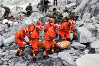 Rescuers retrieved 10 bodies on Sunday as the increasingly desperate search continued for at least 93 people missing a day after a massive landslide buried a mountain village in south-western...
