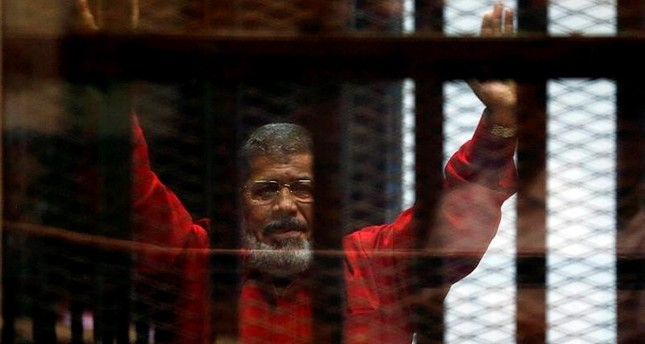 Egyptian regime threatened Morsi before his death, report says